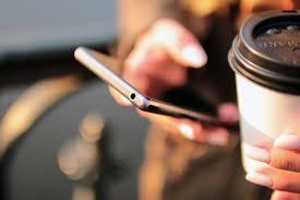 phone-hand-coffee